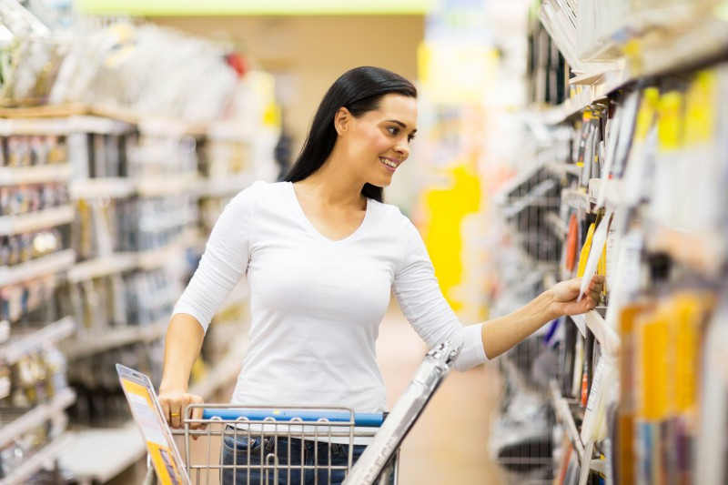 female customer in retail store looking at products in aisle