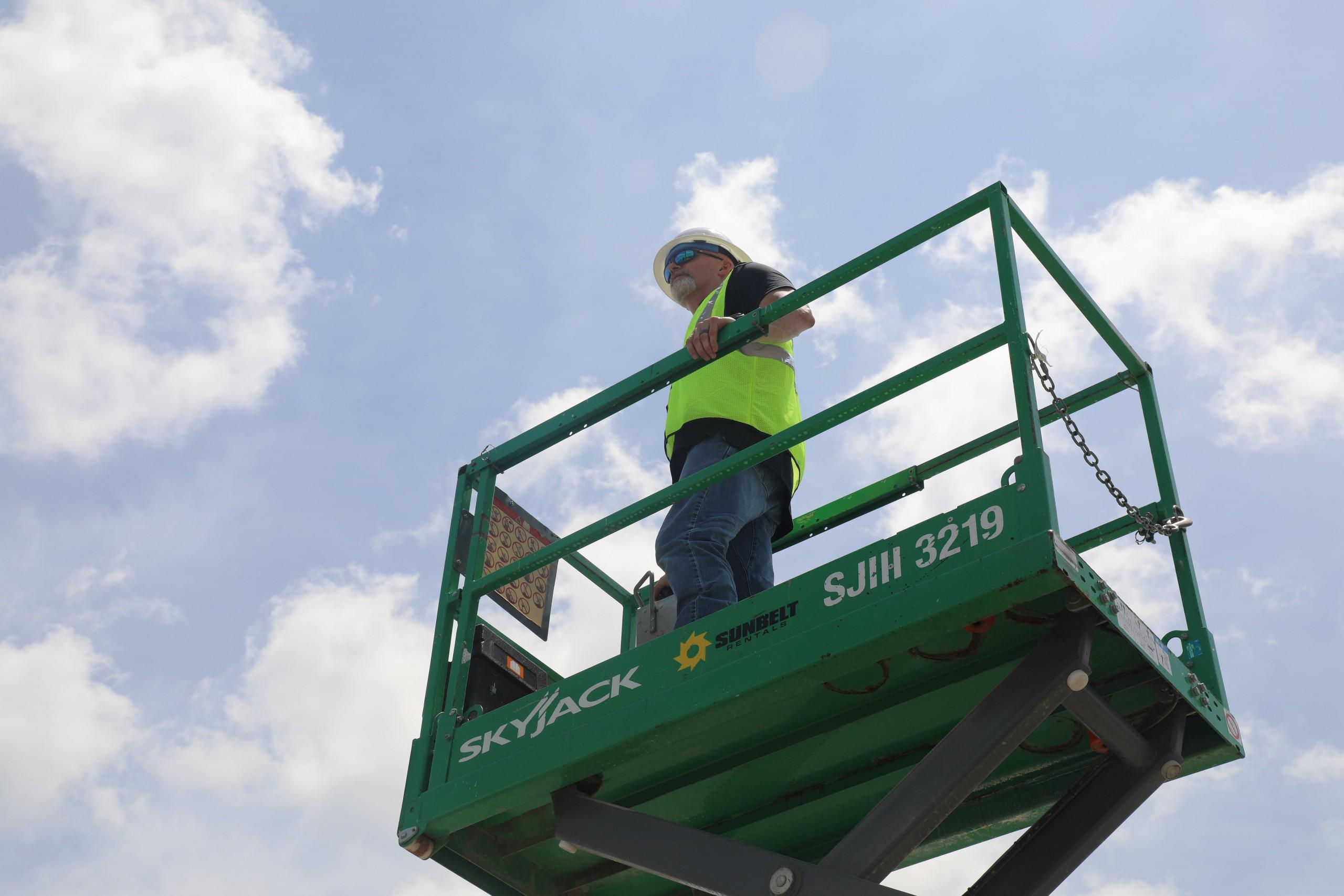Wachter Employee Safely Operating Scissor Lift